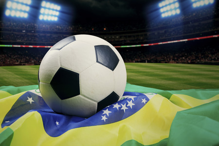 Soccer ball with brazilian flag. shoot at soccer field photo