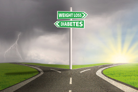 weight control: Guidepost to choose weight loss or diabetes. shoot outdoors Stock Photo