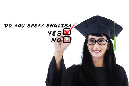 adult learning: Learning language concept. Female student write Do You Speak English?