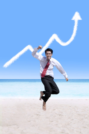 Success businessman and business growing graph cloud at the beach photo