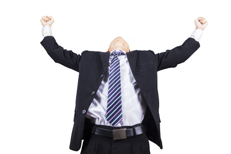 Successful businessman with arms up celebrating his victory photo