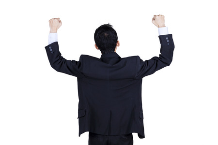 outstretched arms: Rearview of successfull businessman celebrating success. Isolated on white