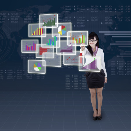 online trading: Success businesswoman one of business chart on virtual future interface