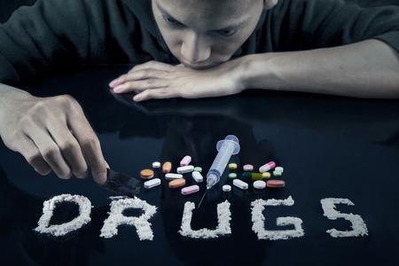 ecstasy pill: Drugs user preparing drugs to used with razor blade Stock Photo