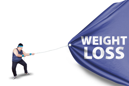 weight loss success: Fat man pulling a weight loss banner, isolated on white background