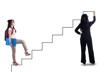 directed: College student stepping up on stairs directed by the teacher to gain her success