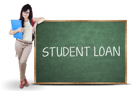 spending full: Female student standing next to student loan text. isolated on white