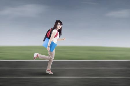 school sports: Student running on tracks. shot outdoors