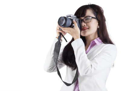 Woman with DSLR camera over white background photo