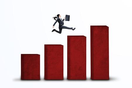 Businesswoman is running over an upward business graph  photo