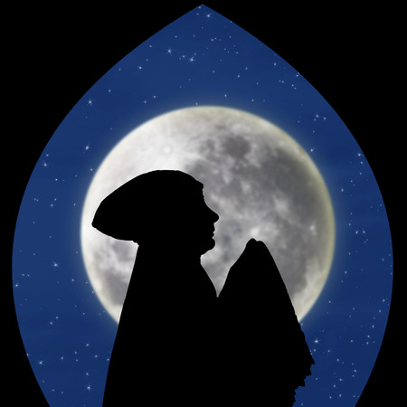 salat: Silhouette of muslimah praying under blue moon Stock Photo