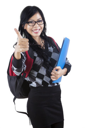 thumbup: Portrait of asian female college student showing thumb-up isolated over white Stock Photo