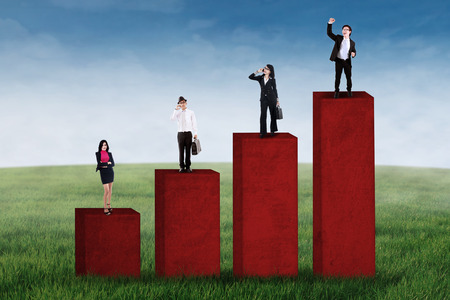 Business growth concept with business group standing on business chart Stock Photo - 30104192