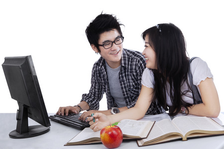 Two asian college students studying together photo