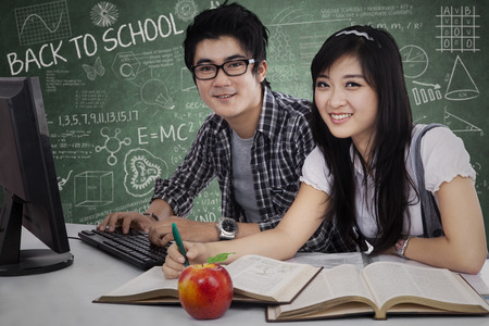 Young Asian students studying together in class Stock Photo