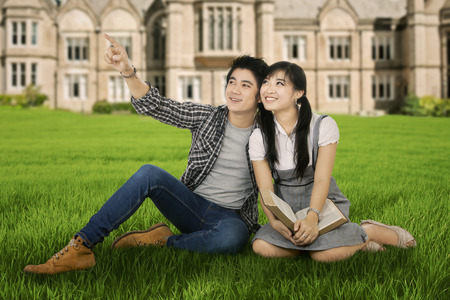 Portrait of two high school students sitting in the park photo