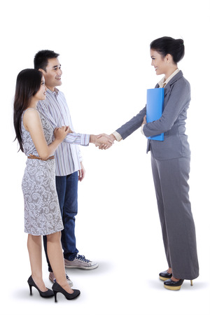 Portair of businesswoman handshaking with her customer photo
