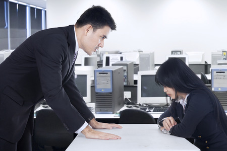 expressing negativity: Businessman is yelling at his employee in the office