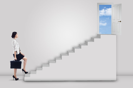 door stepping: Businesswoman stepping up to the door on the sky with an arrow direction & Door Stepping Stock Photos \u0026 Pictures. Royalty Free Door Stepping ... Pezcame.Com