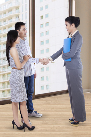 Portrait of asian people in home selling transaction photo