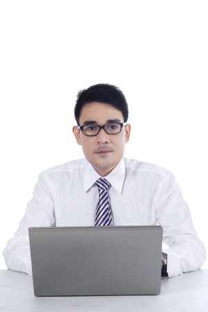 filipino people: Portrait of young asian businessman working with laptop computer