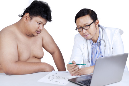 Doctor is presenting the check up result to a fat man. isolated on white background photo