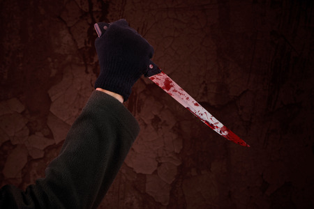 blood dripping: Man with bloody knife, hand close up, dark background