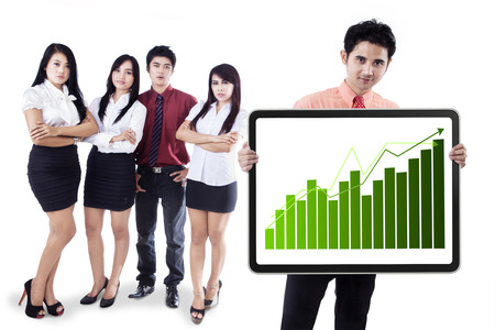 Group of business people showing the growth graph on a banner photo