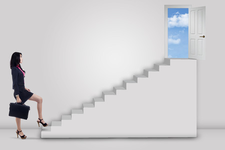 door stepping: Businesswoman stepping up to the door on the sky : door stepping - Pezcame.Com