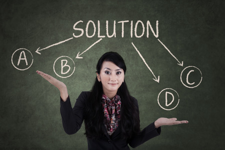 problems solutions: Portrait of a confused businesswoman to choose solution Stock Photo
