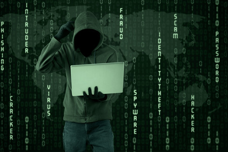 criminal activity: Portrait of confused hacker getting difficult password