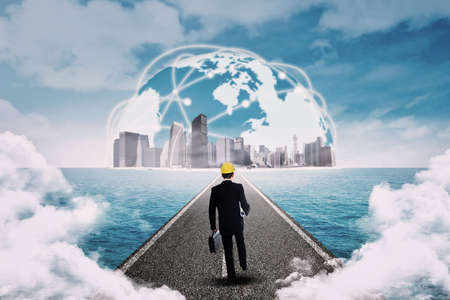 toward: Young businessman walking on the road toward the business global Stock Photo