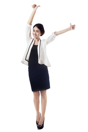 Isolated beautiful businesswoman showing two thumbs up on white  photo