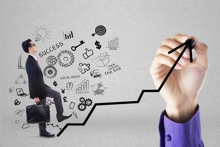 Businessman climbing upward chart to gain her business target by following businessmans hand