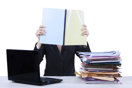 workload: Portrait of businesswoman reads documents at office