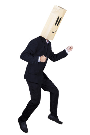 Anonymous businessman with running gesture on white background photo