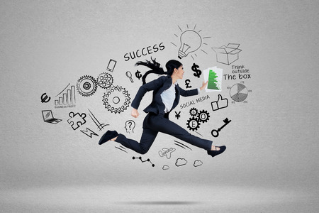chase: Businesswoman running to chase her target for success Stock Photo