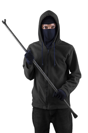 law breaker: Burglar with a crowbar is slink on white background
