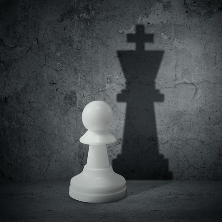 White chess pawn with the shadow of a queen