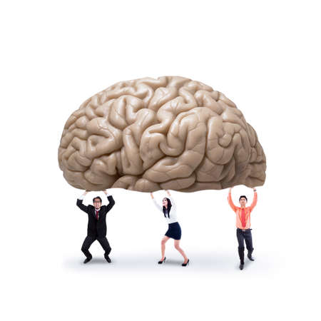 Business team holding a brain, symbolizing a big idea or creativity photo