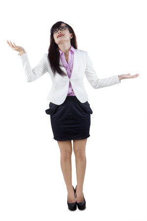 Full length of businesswoman juggling gesture, isolated on white background photo