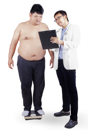 weigher: Doctor measuring the body mass of overweight man with weigher  isolated on white Stock Photo