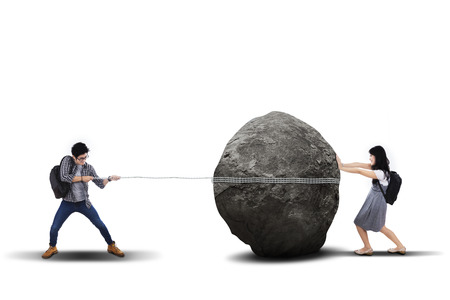 Education problem with students pulling and pushing heavy stone photo