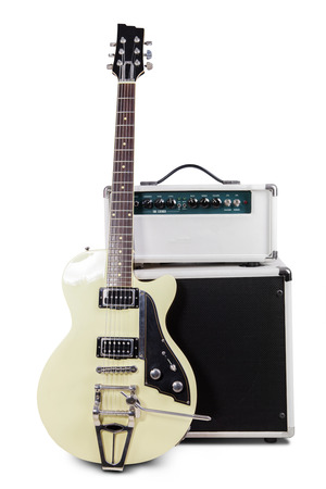 Electric guitar with amplifier, isolated on white background photo