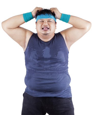 Fat man expressing stressful after failed for dieting photo