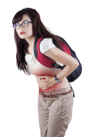 girl belly: Woman having abdominal pain, upset stomach or menstrual cramps Stock Photo