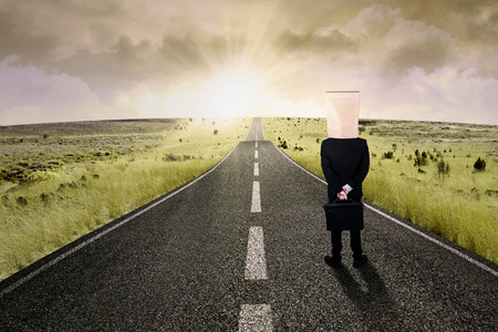 bright future: Businesswoman walk on the road to start her journey and gain bright future