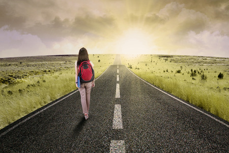Female college student walk on the road to start her journey and gain bright future