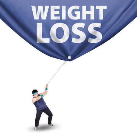 excess: Fat man pulling a weight loss banner, isolated on white background