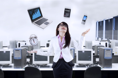 Businesswoman juggling responsibilities in the office photo